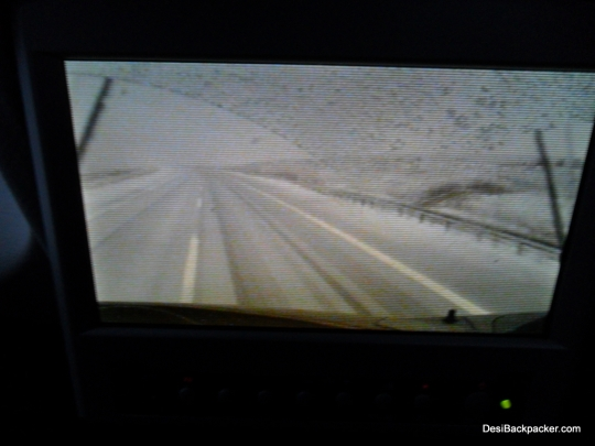 A view of the Snowy Road from the seat-back TV