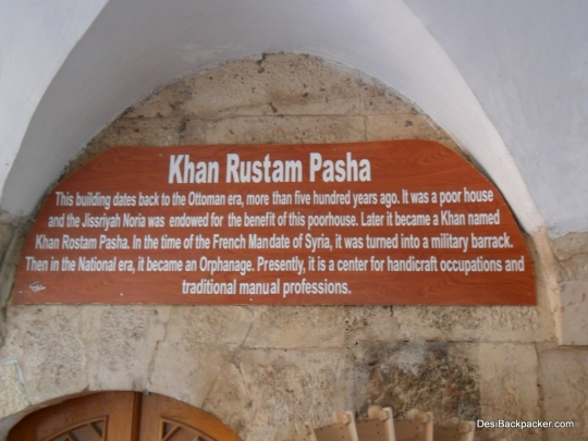 A signboard at the entrance to a former Khan